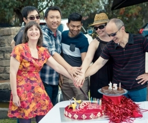 Photo of the Web Prophets team cutting birthday cake