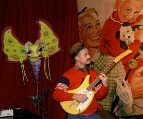 Photo o f the band and butterfly puppet