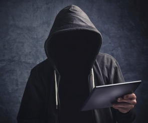 Photo of a computer hacker