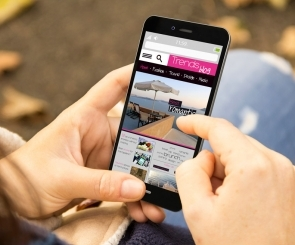 Photo of someone using a mobile to look at website