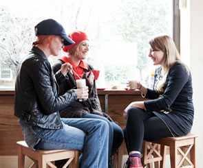 Photo of young women having coffee